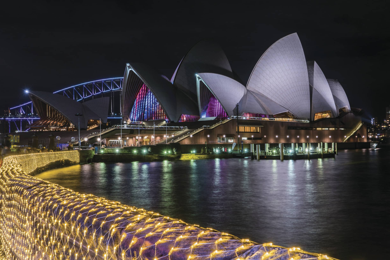 Sydney Opera House and the Sydney Harbour Bridge as viewed from The Royal Botanic Garden, Vivid Sydney 2016.